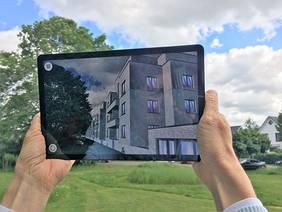 Mit dem Smartphone draufhalten, herunterladen und schon wird der digitale Blick in die Zukunft möglich. Foto: HEC GmbH